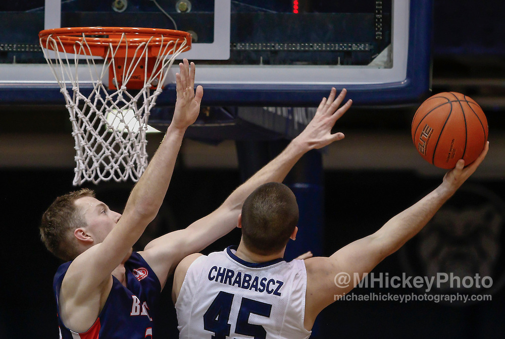 INDIANAPOLIS, IN - DECEMBER 28: Evan Bradds #35 of the Belmont Bruins guards as Andrew Chrabascz #45 of the Butler Bulldogs shoots the ball at Hinkle Fieldhouse on December 28, 2014 in Indianapolis, Indiana. Butler defeated Belmont 67-56. (Photo by Michael Hickey/Getty Images) *** Local Caption *** Evan Bradds; Andrew Chrabascz