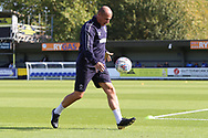 AFC Wimbledon assistant coach Neil Cox warming up the goalkeepers during the EFL Sky Bet League 1 match between AFC Wimbledon and Oxford United at the Cherry Red Records Stadium, Kingston, England on 29 September 2018.