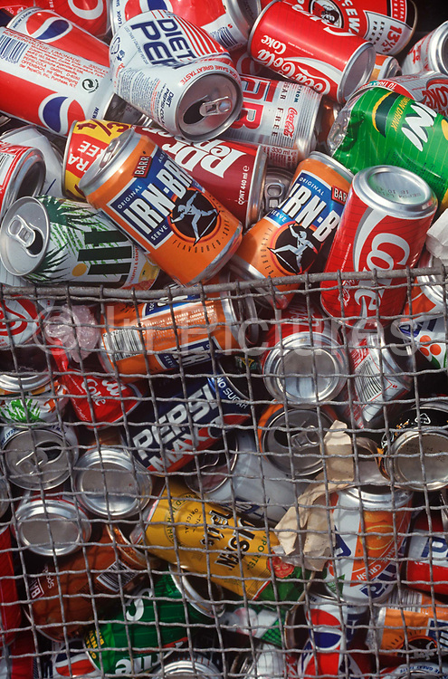 A pile of old 1990s-era drinks cans are piled up in a receptacle basket, on 14th June 1991, in Liverpool, Merseyside, England.