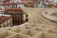 Metropol Parasol is a wooden structure located at La Encarnación square, in the old quarter of Seville, Spain. It was designed by the German architect Jürgen Mayer and is 150 by 70 metres (490 by 230 ft) and an approximate height of 26 metres (85 ft)