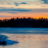 """Ben Wiltsie speeds in a small, high-powered outboard boat called a """"Superdink"""" across Lake of the Woods, Ontario, Canada."""