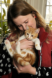 "© under license to London News Pictures. 30.11.2010 House and Collections Manager Alice Martin pictured holding Jock. A new kitten has taken up residence at 'Chartwell' the residence of the late Sir Winston Churchill. The former Prime Minister owned a marmalade coloured cat which he named Jock, after Sir Jock Colville, one of his personal secretaries. On his death, Churchill left wishes that there should always be a cat with four white paws and a white bib ""in comfortable residence"" at Charwell. The original Jock meant so much to Churchill that he attended many war time cabinet meetings with him and rumour has it that meals in the Churchill household did not commence until ginger tabby Jock was present at the table. The current Jock was rescued by The Cats Protection before being adopted by Chatwell's House and Collections Manager, Alice Martin. Picture credit should read Grant Falvey/London News Pictures"
