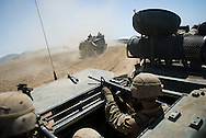 Assault Amphibious Vehicles charge up a hill to deliver Marines to the battlefield during live-fire exercises for the 2nd Battalion, 5th Marine Regiment at Camp Pendleton.