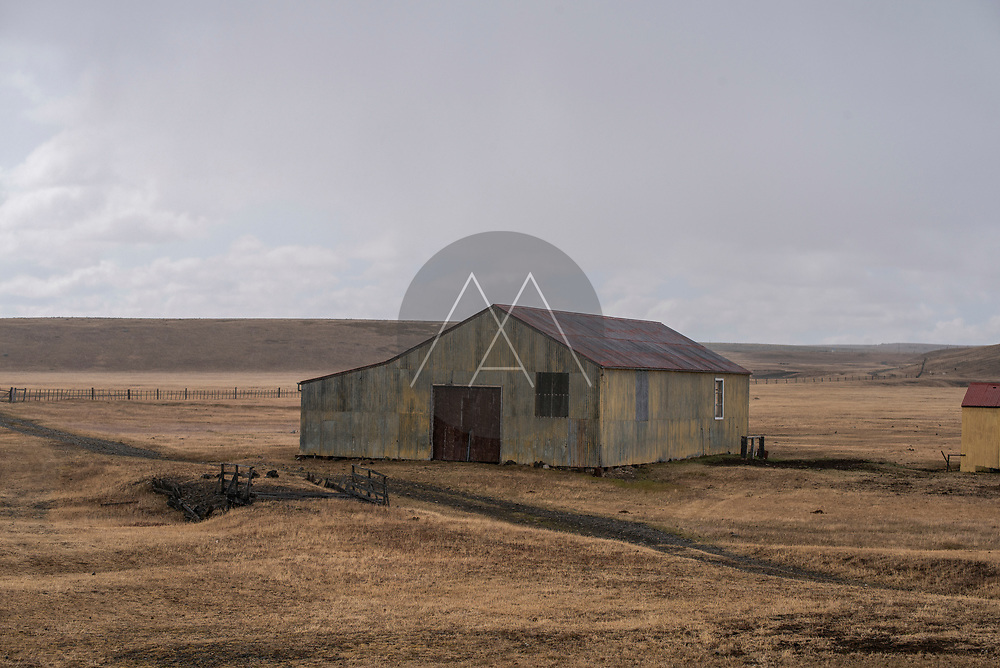 View of a small farm in Chile countryside near Punta Arenas, Chile.