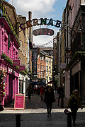 Sign for the famous Carnaby Street W1 on 26th May 2021 in London, United Kingdom. Carnaby Street is a pedestrianised shopping street in Soho in the City of Westminster. Infamous as a street where people would come to parade their fashions in the 1960s, it is home to fashion and lifestyle retailers, including many independent fashion boutiques.