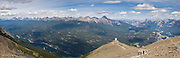 See Victoria Cross Range (left) and Colin Range (right) above Jasper Tramway station atop The Whistlers peak, above Jasper townsite, in Jasper National Park, Canada. Jasper is part of the Canadian Rocky Mountain Parks World Heritage Site declared by UNESCO in 1984. Panorama stitched from 3 images.