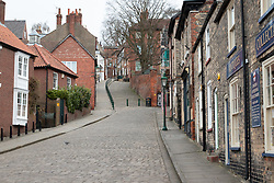 © Licensed to London News Pictures. 17/03/2020. Lincoln, Lincolnshire, UK. Deserted Lincoln. Pictured, an empty Steep Hill usually thronged with commuters making their way to the train station. The streets leading from the top of the City (Bailgate) down to the railway station at the bottom of the City are usually filled with commuters on their way to work unlike this morning as the streets were eerily quiet. Photo credit: Dave Warren / LNP