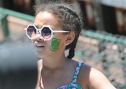 Pretoria 26-12-18. The 1st of three 5 day cricket Tests, South Africa vs Pakistan at SuperSport Park, Centurion. Day 1. Jaime (9) from Primrose, Johannesburg with a  South African stamp on her face in the heat of the day as temperatures soared to around 35deg Celcius.<br /> Picture: Karen Sandison/African News Agency(ANA)<br /> <br /> Picture: Karen Sandison/African News Agency(ANA)