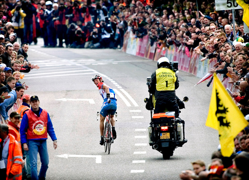 The Netherlands, Valkenburg, 16-04-2006.<br /> Cycling, Amstel Gold Race.<br /> Frank Schleck, the cycling champion of Luxembourg, looks full of joy once more over his shoulder  to see that he will no longer  catched up before the finish line by Steffen Wesemann. Schleck is the surprising winner of the 41st Edition of the Amstel Gold Race.<br /> Photo: Klaas Jan van der Weij