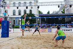 Danijel Pokersnik strikes against Jan Pokersnik and Nejc Zemjlak at Beach Volleyball Challenge Ljubljana 2014, on August 2, 2014 in Kongresni trg, Ljubljana, Slovenia. Photo by Matic Klansek Velej / Sportida.com