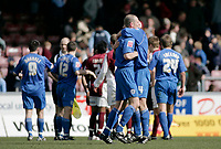 Photo: Marc Atkins.<br /> Northampton Town v Rochdale. Coca Cola League 2. 08/04/2006. <br /> Ernie Cooksey (R) of Rochdale embraces a teammate whilst angry Northampton players surround the referee at the end of the game.