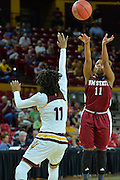 March 18, 2016; Tempe, Ariz;  New Mexico State Aggies guard Shanice Davis (11) shoots over Arizona State Sun Devils guard Peace Amukamara (11) during a game between No. 2 Arizona State Sun Devils and No. 15 New Mexico State Aggies in the first round of the 2016 NCAA Division I Women's Basketball Championship in Tempe, Ariz. The Sun Devils defeated the Aggies 74-52.