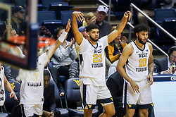 Nov 28, 2018; Morgantown, WV, USA; West Virginia Mountaineers forward Esa Ahmad (23) celebrates from the bench late in the second half against the Rider Broncs at WVU Coliseum. Mandatory Credit: Ben Queen-USA TODAY Sports