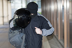 © Licensed to London News Pictures . 23/02/2015 Manchester , UK . PC KEVIN DWYER (39) , of Greater Manchester Police's North Manchester Division , running from Manchester Crown Court . Dwyer has today (23rd February 2015) been sentenced for two counts of voyeurism and ten counts of outraging public decency that took place whilst he was serving as a police officer . VIDEO AVAILABLE - SEE https://www.youtube.com/watch?v=g5KEh4WM0gw  Photo credit : Joel Goodman/LNP