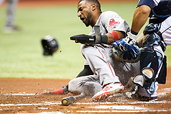 August 9, 2017 - St. Petersburg, Florida, U.S. - WILL VRAGOVIC   |   Times.Boston Red Sox second baseman Eduardo Nunez (36) tagged by Tampa Bay Rays catcher Wilson Ramos (40) attempting to score on the fielders choice by Boston Red Sox designated hitter Hanley Ramirez (13) in the first inning of the game between the Boston Red Sox and the Tampa Bay Rays at Tropicana Field in St. Petersburg, Fla. on Wednesday, August 9, 2017. (Credit Image: © Will Vragovic/Tampa Bay Times via ZUMA Wire)