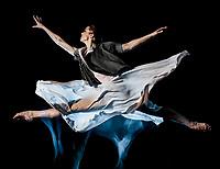 one caucasian woman modern ballet dancer dancing woman studio shot isolated on black bacground