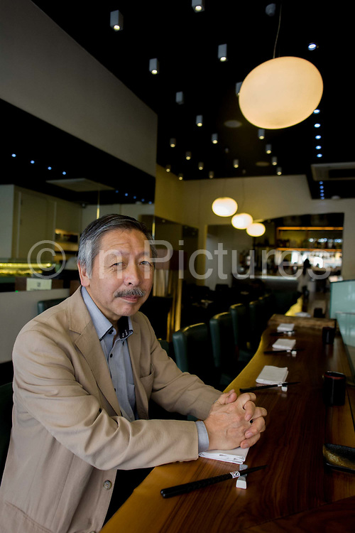 Japanese entrepreneur, Tetsuro Hama at his 'So' restaurant, Soho, London. Hama is the owner of So plus a north London car dealership. He arrived from Japan in 1973, looking for business opportunities before starting a hotel in a Bayswater backstreet. He then went into the restaurant industry, soon earning the respect of employees and customers for affordable and tasty sushi. <br /> From the chapter entitled 'The Price of Happiness' and from the book 'Risk Wise: Nine Everyday Adventures' by Polly Morland (Allianz, The School of Life, Profile Books, 2014).