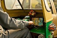 A close up of a auto  rickshaw drivers handlebars as he navigates the busy Delhi Streets, India