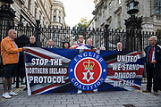 Loyalists hold a banner in front of Downing Street during a demonstration against the Northern Ireland Protocol between the United Kingdom and the European Union on 9th October 2021 in London, United Kingdom. The Northern Ireland Protocol was agreed in Brexit talks between the UK and the EU in order to protect the 1998 Good Friday Agreement and it was implemented so as to avoid a hard border between Northern Ireland and the Republic of Ireland.