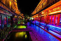 Bar Street (Xinhua Street) in Dayan (The Old Town), Lijiang, Yunnan Province, China. The Old Town is a UNESCO World Heritage Site.