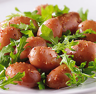 New potatoes and rocket leaves salad with a mustard dressing food photos