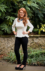 © Licensed to London News Pictures. 25/01/2013. London, UK. Liz Evans (27), Slimming World's Miss Slinky 2013, is seen in the garden of the Ritz Hotel in London today (25/01/13). Liz, formerly a size 18, lost 5 stone in less than eight months to become a size 8 in preparation for her wedding day. Photo credit: Matt Cetti-Roberts/LNP