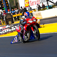 GAINESVILLE, FL - MAR 11, 2011:  Driver, Mike Berry, brings his Pro Stock Motorcycle down the track during a qualifying run for the Tire Kingdom NHRA Gatornationals race in Gainesville, FL.