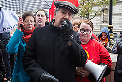 London, UK. 12 November, 2019. John Rees of the People's Assembly addresses McDonald's workers belonging to the Bakers Food & Allied Workers Union (BFAWU) assembled opposite Downing Street during strike action, dubbed a 'McStrike', to call for a New Deal for McDonald's Workers which would include £15 an hour, an end to youth rates, the choice of guaranteed hours of up to 40 hours a week, notice of shifts four weeks in advance and union recognition.