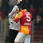 Referee's Serkan Cinar show the yellow card to Galatasaray's Gokhan Zan during their Turkish Superleague soccer match Galatasaray between Orduspor at the AliSamiyen Spor Kompleksi TT arena in Istanbul Turkey on Monday 25 February 2013. Photo by Aykut AKICI/TURKPIX