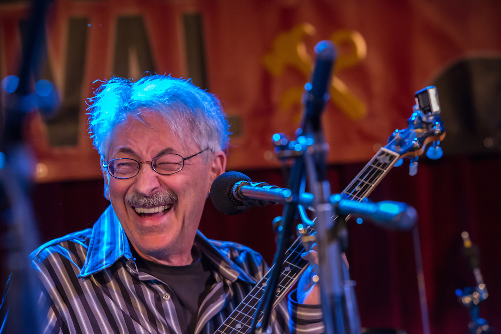Peter Stampfel laughing after a song at the Brooklyn Folk Festival.