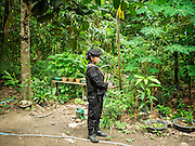 17 JUNE 2015 - RANGAE, NARATHIWAT, THAILAND: A Thai Army woman Ranger on a defensive perimeter while members of her unit performed wellness checks during a mission in a Muslim village in Narathiwat. There are 5 platoons of women Rangers serving in Thailand's restive Deep South. They generally perform security missions at large public events and do public outreach missions, like home wellness checks and delivering food and medicine into rural communities. The medics frequently work in civilian clothes because the Rangers found people are more relaxed around them when they're in civilian clothes. About 6,000 people have been killed in sectarian violence in Thailand's three southern provinces of Narathiwat, Pattani and Yala since a Muslim insurgency started in 2004. Attacks usually spike during religious holidays. Insurgents are fighting for more autonomy from the central government in Bangkok.     PHOTO BY JACK KURTZ