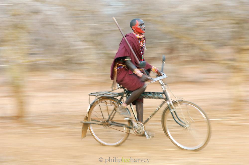 Maasai man cycling, Tipilit Village, near Amboseli National Park, Kenya