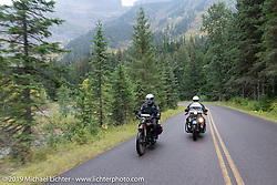 Ziggy and Steve Rinker ride their Indians through Glacier National Park during the Motorcycle Cannonball coast to coast vintage run. Stage 12 (242 miles) from Great Falls to Kalispell, MT. Thursday September 20, 2018. Photography ©2018 Michael Lichter.