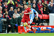 Alberto Moreno of Liverpool (l) passes the ball back under pressure from Rajiv van La Parra of Huddersfield Town. Premier League match, Liverpool v Huddersfield Town at the Anfield stadium in Liverpool, Merseyside on Saturday 28th October 2017.<br /> pic by Chris Stading, Andrew Orchard sports photography.