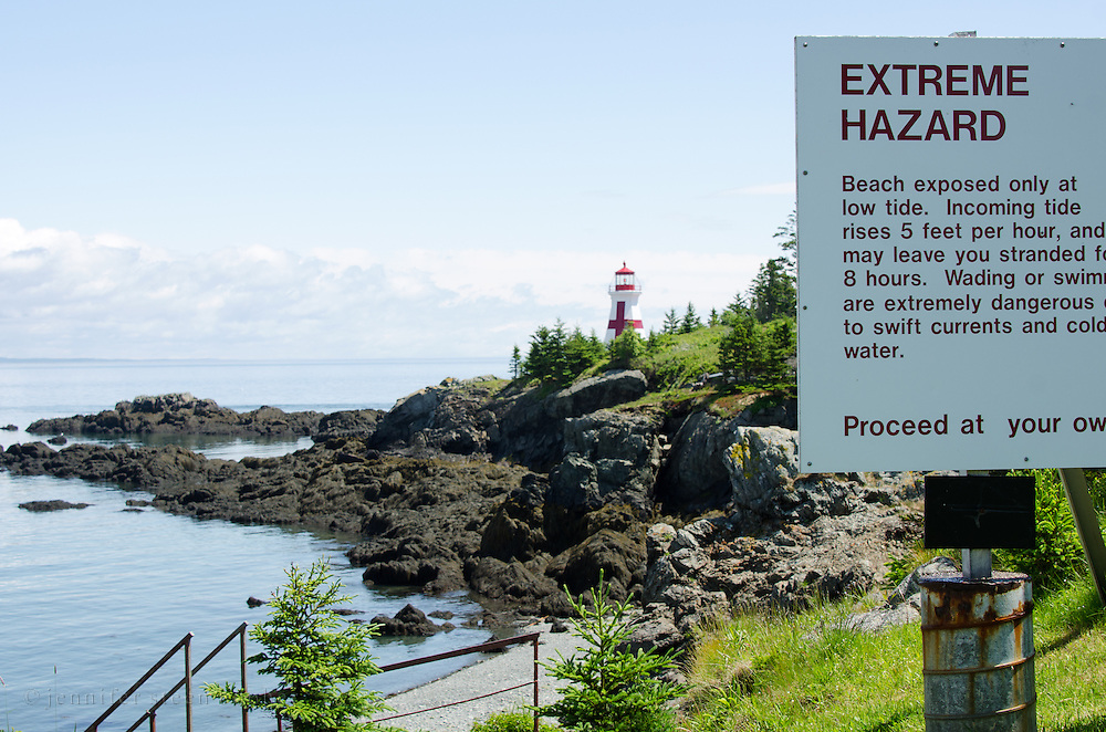 Warning sign along the path to Head Harbor Light, Campobello Island. The path is covered at high tide.