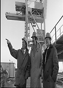 Tanaiste,Dick Spring,Visits Moneypoint..1984..23.11.1984..11.23.1984..23rd November 1984..The Tanaiste and Minister for Energy,Mr Dick Spring,visited Moneypoint Generating Station,Co Clare. He visited the site to view the progress of work there...Pictured with a backdrop of a huge crane ,Mr Heber McMahon,site manager,points out some of the highlights of the work in progress to Tanaiste, Mr Dick Spring TD,.andMr P.J.Moriarty, Chief Executive Officer,ESB.