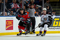 KELOWNA, BC - DECEMBER 18: Connor Horning #22 of the Vancouver Giants checks Ethan Ernst #19 of the Kelowna Rockets during first period at Prospera Place on December 18, 2019 in Kelowna, Canada. (Photo by Marissa Baecker/Shoot the Breeze)