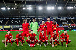 SWANSEA, WALES - Thursday, November 12, 2020: Wales players line-up for a team group photograph before an International Friendly match between Wales and the USA at the Liberty Stadium. Back row L-R: James Lawrence, goalkeeper Daniel Ward, Dylan Levitt, Kieffer Moore, Rabbi Matondo. Front row L-R: Tom Lockyer, Connor Roberts, captain Chris Gunter, Harry Wilson, Tom Lawrence, Matthew Smith. (Handout/FAW)