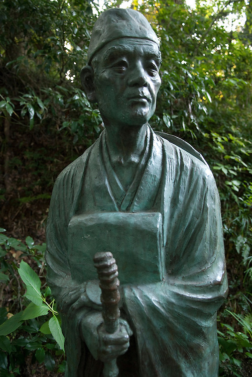 """A statue of Matsuo Basho at Chusonji temple, Hiraizumi, Japan, 28 August 2008. The poet visited Hiraizumi during the writing of the Narrow Road to the Deep North. Hiraizumi in Northern Japan flourished as the seat of the Oshu Fujiwara clan for around 100 years from the end of the 12th century. The city was built to be an earthly recreation of the Buddhist """"Pure Land"""" or Nirvana."""