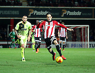 Brentford midfielder/ forward (Ramallo) Jota  driving forward during the Sky Bet Championship match between Brentford and Huddersfield Town at Griffin Park, London, England on 19 December 2015. Photo by Matthew Redman.