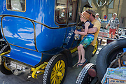A child admired a visiting vintage car in the centre of a French village, during a three-day rally journey through the Corbieres wine region, on 26th May, 2017, in Lagrasse, Languedoc-Rousillon, south of France. Lagrasse is listed as one of Frances most beautiful villages and lies on the famous Route 20 wine route in the Basses-Corbieres region dating to the 13th century.