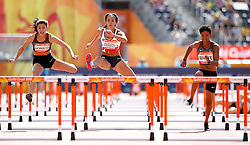 England's Katarina Johnson-Thompson (2nd left)) with Canada's Nina Schultz (left), Canada's Angela White (2nd right) and England's Katie Stainton (right) falling during the 100m Hurdles element of the Women's Heptathlon, at the Carrara Stadium during day eight of the 2018 Commonwealth Games in the Gold Coast, Australia.