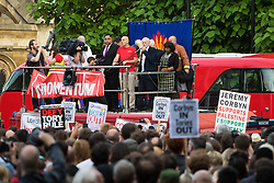 Parliament Square, Westminster, London, June 27th 2016. Thousands of Labour's Momentum members and their supporters gather in Parliament Square in a display of support for embattled Labour Leader Jeremy Corbyn as he suffers numerous calls for his resignation by party members, saying he has does not have the authority to lead the divided party, following his less than emphatic support for Remain in the EU referendum. PICTURED: Standing on the FBU's fire truck, Jeremy Corbyn, with Diane Abbott to his left, addresses the crowd.
