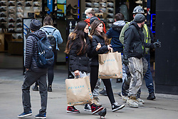 © Licensed to London News Pictures.  12/04/2021. London, UK. Shoppers are seen at Oxford Street, central London as the government takes the next step on its lockdown-lifting road map and non-essential shops re-open today. Photo credit: Marcin Nowak/LNP