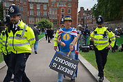 Police officers remove Steve Bray of pro remain protest group Stand of Defiance European Movement for dispupting a live news broadcast on College Green on 24th May 2019 in London, England, United Kingdom. Todays announcement by Britains Prime Minister to step down on the 7th June has started a leadership race in the Conservative Party.