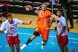 The Dutch handball player Patrick Miedema and Can Celebi in action during the European Championship qualifying match against Turkey in the Topsport Center Almere.