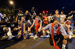 Clergy pray with protesters outside the Charlotte Police Dept. after ignoring the curfew on Sunday, September 25, 2016 in Charlotte, NC, USA. Protesters came together for the fifth straight night to protest following the fatal shooting of Keith Lamont Scott. Keith Lamont Scott was shot and killed by Charlotte-Mecklenburg Police Officer Brentley Vinson on Tuesday afternoon. Photo by Jeff Siner/Charlotte Observer/TNS/ABACAPRESS.COM