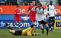 Photo:  Frances Leader.<br /> Luton Town v Swindon Town. Coca Cola league one. <br /> Kenilworth Road Stadium.<br /> 12/03/2005<br /> Luton's Peter Holmes dodges past Swindon's goalie Rhys Evans to score his goal against Swindon.