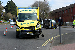 Southampton,Hampshire, Tuesday  22nd March 2016 Pictured<br /> A woman was rushed to hospital with injuries after an ambulance answering an emergency call  in the West of Southampton crashed with her vehicle on a busy road in Southampton.<br /> <br /> Emergency services were called to Oakley Road in Southampton just after 9.20pm following the reports of a collision involving an ambulance and two other vehicles.<br /> <br /> Officers from the Roads Policing unit at based at Totton closed off the road whilst Fire crews from Redbridge, St Mary's and Cosham  battled to free the driver and passenger who were trapped in their vehicle that was on its side.<br /> <br /> <br /> The scene show  vehicles were badly damaged with debris strewn on the road<br /> <br /> Fire Crews using a reciprocating saw and specialist equipment cut a hole in the  roof of the Skoda Scout to free the trapped couple  who vehicle was on it's side.  The Woman was rushed to Southampton General hospital with Injuries.<br /> <br /> A second vehicle, red Skoda was also involved in the collision. The driver, a woman in her 40s, was shocked but unharmed. ©UKNIP A CAR overturned on a busy junction in Southampton after a crash involving an ambulance this morning.The grey Skoda was lying on its side at the crossroads of Tebourba Way and Oakley Road.A second, red Skoda was also involved in the collision and was parked up nearby. The driver, a woman in her 40s, was shocked but unharmed.<br /> <br /> Traffic on Tebourba Way was being diverted while Oakley Road was closed following the collision, which happened shortly before 9.20am this morning.<br /> <br /> It finally reopened just after 11am.