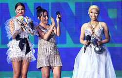 Sofia Reyes, Anitta and Nicki Minaj on stage with her Best Hip Hop Award during the MTV Europe Music Awards 2018 held at the Bilbao Exhibition Centre, Spain